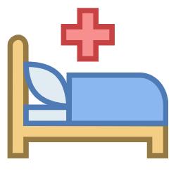 Krankenbett mit einem Kreuz